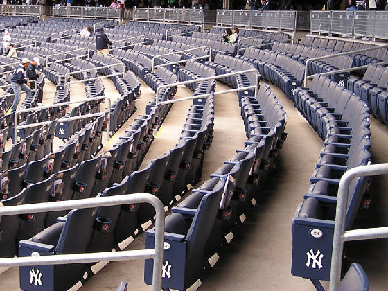 "The seats in the lower level at ""The Stadium"""